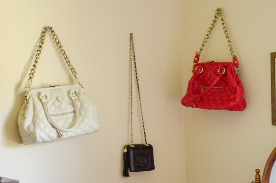 handbags hanging on wall